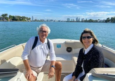A couple pose for a photo during a Miami boat tour